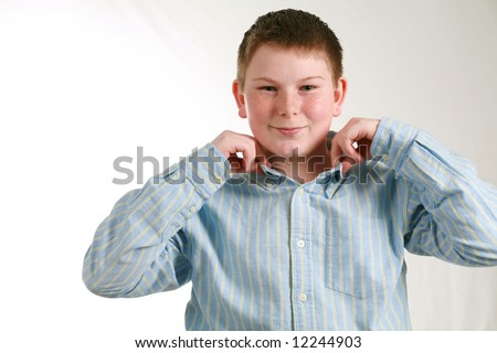 portrait of husky boy with freckles in dress shirt - stock photo