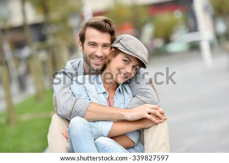 Portrait of in love young couple in town - stock photo