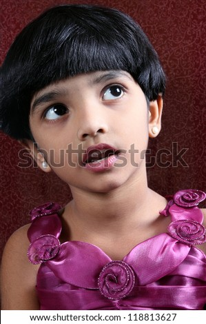 Portrait Of Indian Girl Looking Up - stock photo