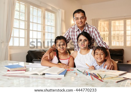 Portrait of Indian parents and children at home - stock photo