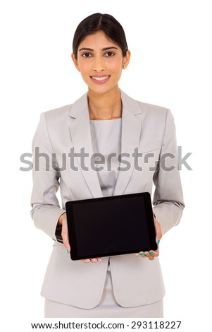 portrait of indian woman presenting tablet computer - stock photo