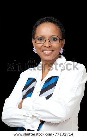 Portrait of intellegent African American business woman wearing white shirt, scarf and glasses - stock photo