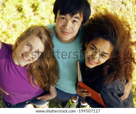 portrait of international group of students close up smiling, blond girl, asian boy, young african woman - stock photo