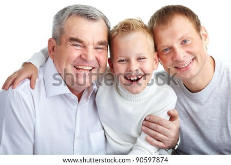 Portrait of joyful father, grandfather and son looking at camera - stock photo