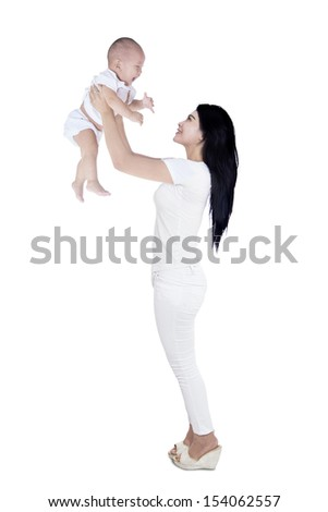 Portrait of joyful mother and her baby having fun isolated on white background - stock photo