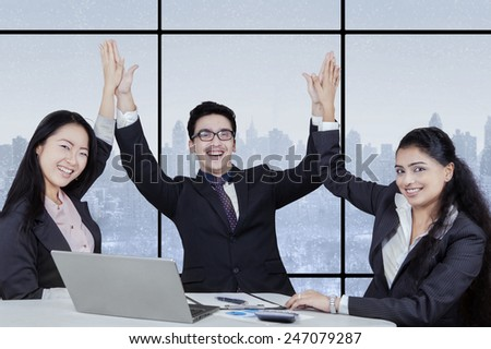 Portrait of joyful multicultural business team smiling at the camera - stock photo