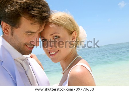 Portrait of just married couple on the beach - stock photo