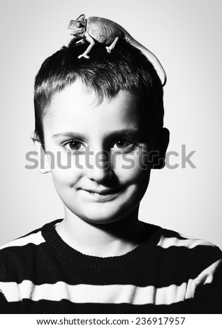 Portrait of kid with chameleon in head against white background - stock photo