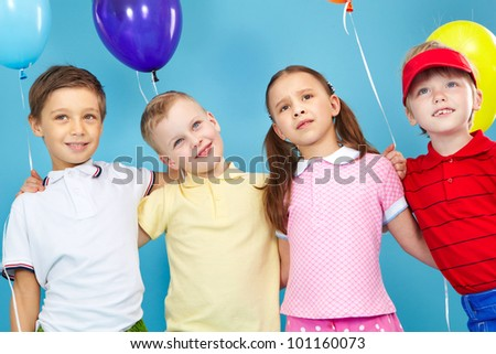 Portrait of kids holding colorful balloons - stock photo