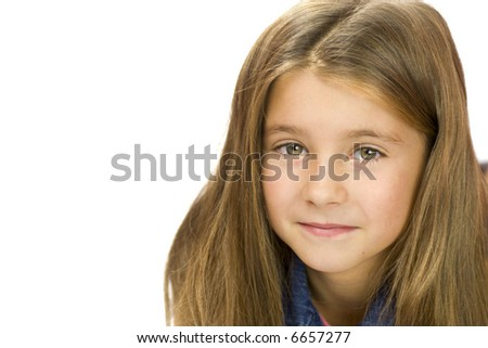 Portrait of kind scjool girl looking at you with warm smile isolated on white - stock photo
