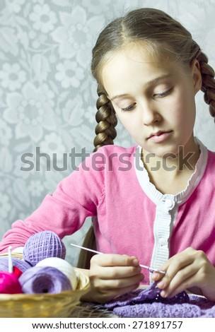 Portrait of knitting little girl  - stock photo