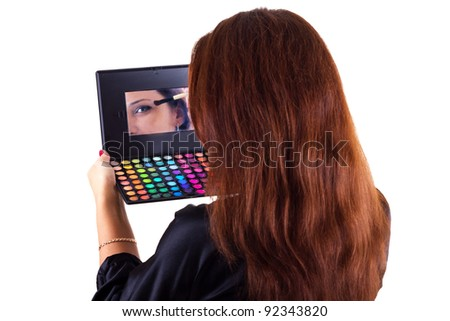 Portrait of lady with eyeshadow and brush isolated on white - stock photo