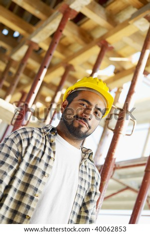Portrait of latin american construction worker looking at camera. Copy space - stock photo