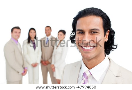 Portrait of latin businessman smiling with his team on the background - stock photo