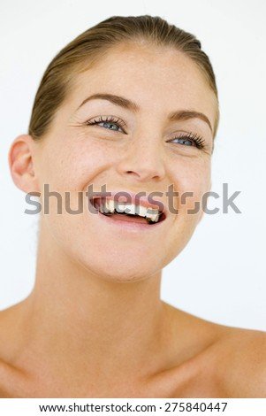 Portrait of laughing blond young woman. - stock photo