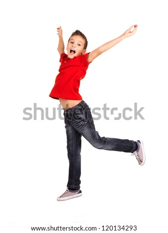 Portrait of  laughing happy boy jumping with raised hands up - isolated on white background - stock photo