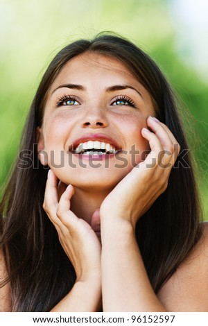 Portrait of laughing young woman with bared shoulders. - stock photo