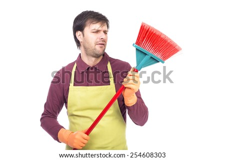 Portrait of lazy young man holding a sweep,conceptual image, over white background - stock photo
