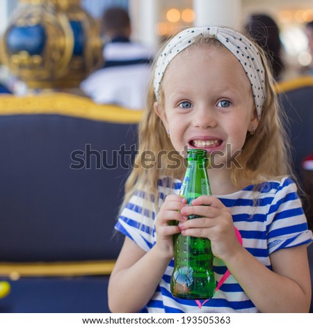 Portrait of little adorable charming girl with bottle water - stock photo