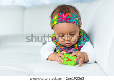 Portrait of little African American little girl playing - Black people - stock photo