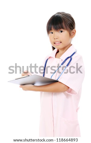 Portrait of little asian girl nurse holding a clipboard - stock photo