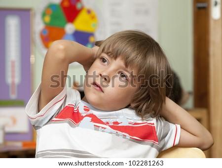 Portrait of little boy in the kindergarten - stock photo