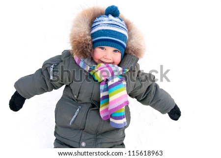 Portrait of little boy in winter  clothes outdoor in wintertime - stock photo