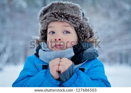 Portrait of little boy in winter time - stock photo