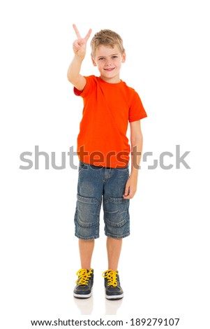 portrait of little boy showing victory hand sign - stock photo