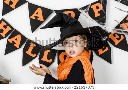 Portrait of little boy wearing halloween costume with pumpkin on white background  - stock photo