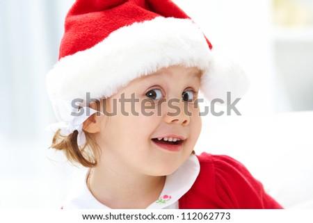 Portrait of little cute girl in santa suit - stock photo