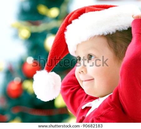Portrait of little cute girl with Christmas present - stock photo