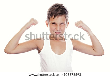 Portrait of little european boy flexing biceps. Isolated on white background - stock photo