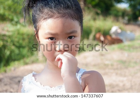 Portrait Of little girl Biting Nails. - stock photo