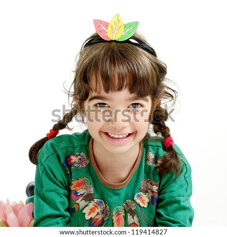 Portrait of little girl dressed in indian costume - stock photo