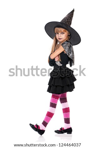 Portrait of little girl in black hat isolated on white background - stock photo