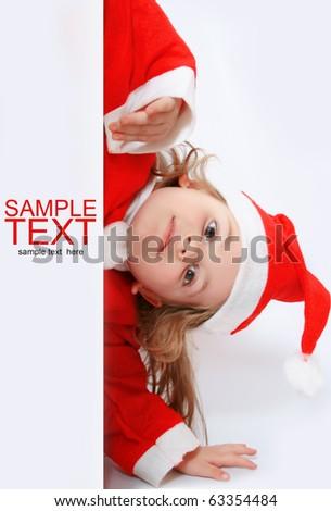 Portrait of little girl in Santa's hat - stock photo