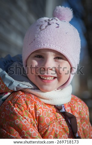 Portrait of little girl in winter clothes - stock photo