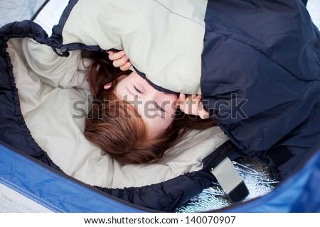 Portrait Of Little Girl Lying In Sleeping Bag - stock photo