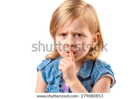 Portrait of little girl making hush sign - stock photo