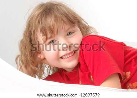Portrait of little girl on red. Smile face - stock photo