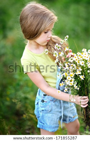 portrait of little girl outdoors in summer - stock photo