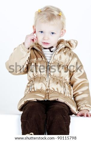 portrait of little girl showing her earrings - stock photo