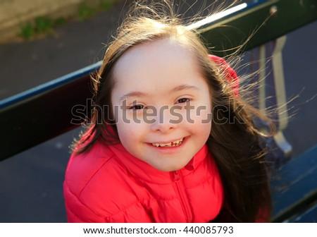 Portrait of little girl smiling outside - stock photo