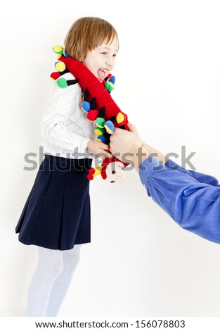 portrait of little girl with a toy - stock photo