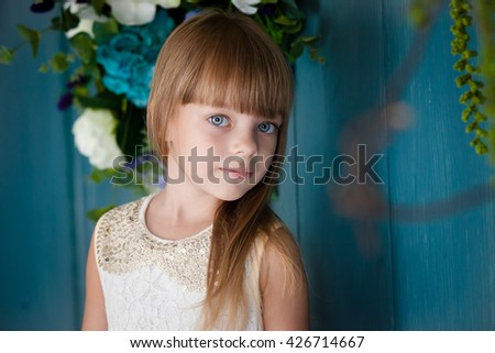 Portrait of little girl with blue eyes  - stock photo