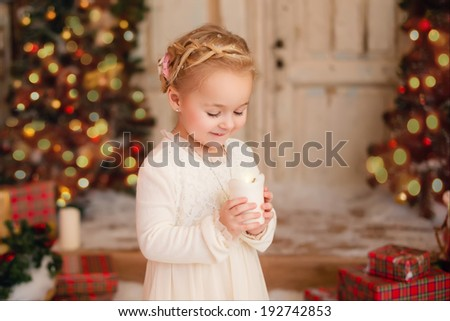 Portrait of  little girl with candle - stock photo