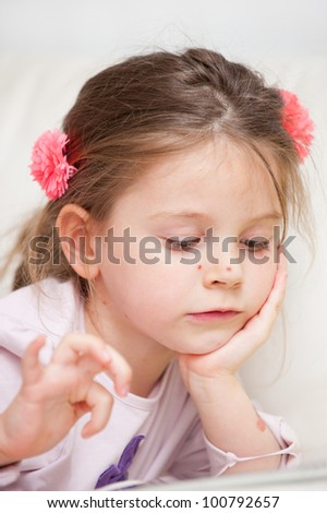 Portrait of little girl with chickenpox - stock photo