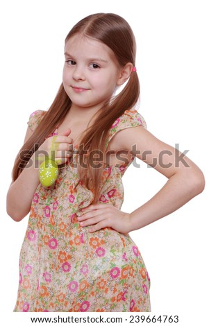 Portrait of little girl with red Easter egg isolated over white background/Pretty little girl holding a chicken egg for Easter - stock photo