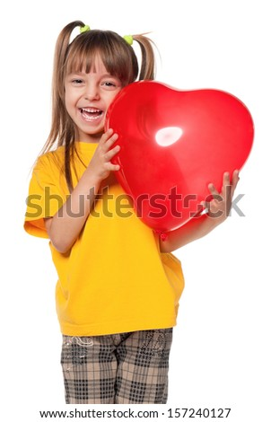 Portrait of little girl with red heart balloon - stock photo